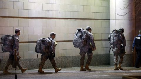 Members of the Missouri National Guard are escorted out of the Buzz Westfall Justice Center.