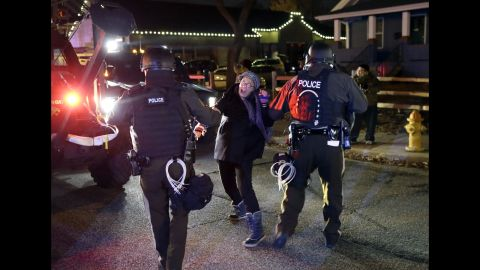 Police officers grab a protester on November 24.