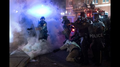 Riot police clash with protesters on November 24.