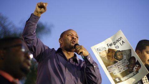 Community activist Najee Ali speaks in Los Angeles' Leimert Park on November 24.