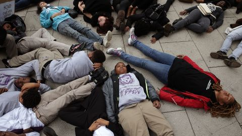 """Schoolchildren from the Potomac Preparatory Charter School take part in a """"die-in"""" during a protest outside the Office of Police Complaints as part of a planned """"28 Hours for Mike Brown"""" protest November 25 in Washington."""