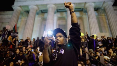 Demonstrators gather on the steps of the National Portrait Gallery in Washington on Tuesday, November 25.