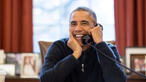President Barack Obama makesThanksgiving Day phone calls to U.S. troops, from the Oval Office in this photo provided by the White House.