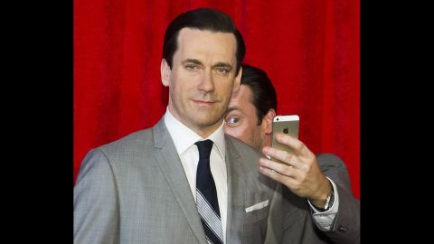 Actor Jon Hamm takes a selfie with his wax figure after it was unveiled Friday, May 9, at Madame Tussauds in New York.