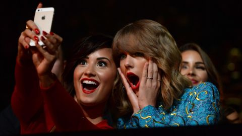 """Recording artists Demi Lovato, left, and Taylor Swift take a selfie at the MTV Video Music Awards on Sunday, August 24. Lovato <a href=""""http://instagram.com/p/sGsETpOKp6/?modal=true"""" target=""""_blank"""" target=""""_blank"""">posted the selfie</a> to her Instagram account."""