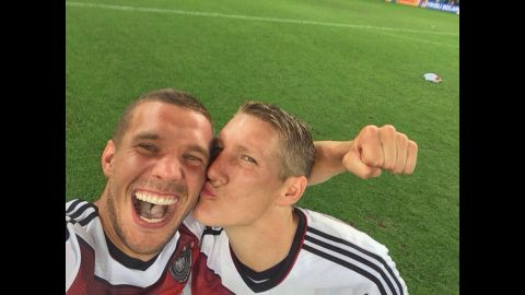"""German soccer player Lukas Podolski <a href=""""https://twitter.com/Podolski10/status/488445583104155648/photo/1"""" target=""""_blank"""" target=""""_blank"""">gets a kiss</a> from teammate Bastian Schweinsteiger as they celebrate their World Cup victory Sunday, July 13, in Rio de Janeiro. <a href=""""http://www.cnn.com/2014/07/13/worldsport/gallery/world-cup-final-germany-argentina-2014/index.html"""">Germany defeated Argentina 1-0 in extra time</a> for the country's fourth World Cup title."""