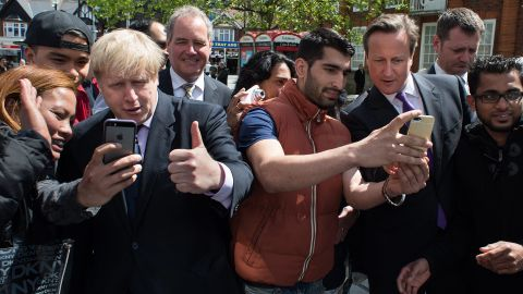 """London Mayor Boris Johnson, third from left, and British Prime Minister David Cameron, third from right, take selfies with locals as they campaign in London on Monday, May 12. Cameron <a href=""""http://www.standard.co.uk/news/politics/david-cameron-selfie-craze-makes-campaigning-take-a-lot-longer-9361937.html"""" target=""""_blank"""" target=""""_blank"""">told the London Evening Standard</a> that the selfie craze these days makes campaigning take longer. """"You can be walking down the street for a chat, but until you've got the selfie out of the way people aren't ready to talk,"""" he said."""