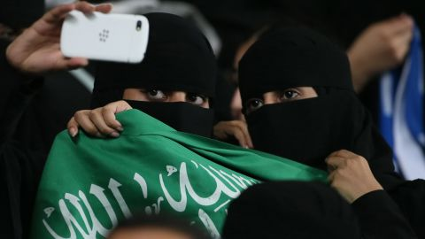 Women take a selfie as they attend a soccer match in Al Ain, Saudi Arabia, on Tuesday, September 30.