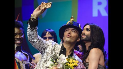 """German actor Julian Stoeckel takes a selfie with Austrian singer Conchita Wurst, right, during a gala in Berlin on Friday, June 20. Wurst, the onstage drag persona of Thomas Neuwirth, won this year's <a href=""""http://www.cnn.com/2014/05/11/world/europe/eurovision-ukraine-russia-conchita-wurst/index.html"""">Eurovision Song Contest.</a>"""