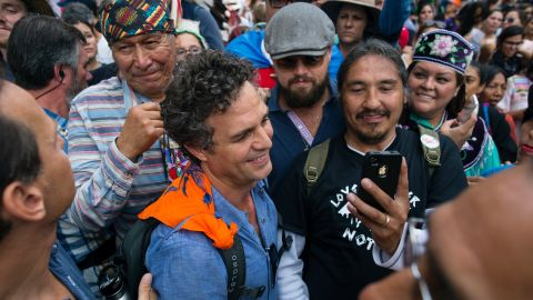 Actors Mark Ruffalo (curly hair) and Leonardo DiCaprio (sunglasses) join the People's Climate March in New York on Sunday, September 21. Thousands of demonstrators filled the streets of Manhattan as they urged policymakers to take global action on climate change.