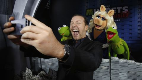 """Actor Ricky Gervais takes a selfie with some of his """"Muppets Most Wanted"""" co-stars at the movie's premiere Tuesday, March 11, in Hollywood."""