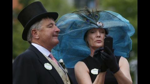 Peter Foster and Gillian Kirby take a selfie on the second day of the Royal Ascot horse-racing event Wednesday, June 18, in Ascot, England.