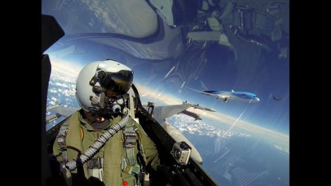 """A pilot with the Royal Netherlands Air Force F-16 Demo Team posted this <a href=""""https://www.facebook.com/192563392398/photos/pb.192563392398.-2207520000.1417098166./10152215946312399/?type=3&theater"""" target=""""_blank"""" target=""""_blank"""">photo from the cockpit</a> on Sunday, June 8. To the pilot's left is a Boeing 787 Dreamliner, the first for Dutch airline Arke."""