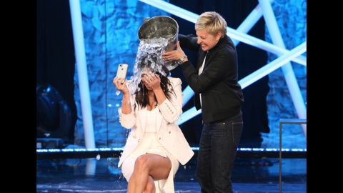 """Television host Ellen DeGeneres dumps a bucket of ice water on Kim Kardashian during an episode of """"Ellen"""" that aired Tuesday, September 9. It was part of the ALS Ice Bucket Challenge, a social media campaign that has been raising awareness and money to fight Lou Gehrig's disease, which is also called amyotrophic lateral sclerosis or ALS."""
