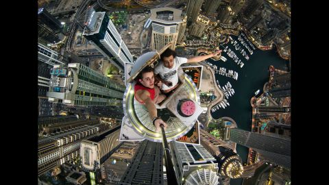 Russian daredevils Alexander Remnev, left, and Volodya Sidorov take a selfie Thursday, January 30, after scaling the Princess Tower, a skyscraper in Dubai, United Arab Emirates.