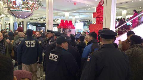 Demonstrators enter Macy's in Manhattan's Herald Square, urging shoppers to boycott Black Friday.