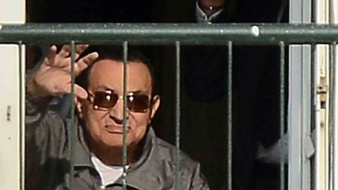 Egypt's former president Hosni Mubarak waves to his supporters from the balcony of his room at the Maadi military hospital in Cairo on November 29, 2014 after a court dismissed a murder charge against the ousted leader over the deaths of protesters during a 2011 uprising that ended the former strongman's decades-long rule. The court also acquitted Mubarak of a corruption charge, but he will remain in prison because he is serving a three-year sentence in a separate corruption case. AFP PHOTO/AL-WATAN NEWSPAPER/MOHAMED NABILMOHAMED NABIL/AFP/Getty Images