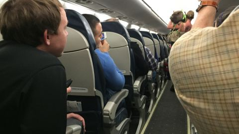 """Passenger Robert Phelps took a picture after this passenger was asked to leave a US Airways flight with her """"disruptive"""" pig."""