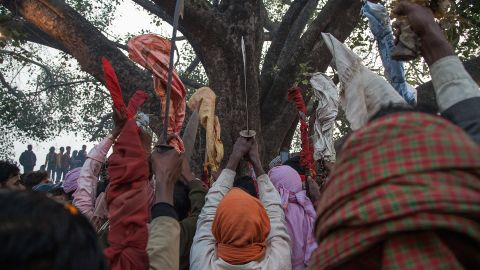 A group of devotees elevate as a blessing their traditional kukri knifes before the beginning of the animal sacrifices during the celebration of the Gadhimai festival on November 28 in Bariyarpur, Nepal.
