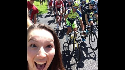 """Cyclist Alberto Contador gives a thumbs-up while fan Katie Holroyde <a href=""""http://instagram.com/p/qEiCoWSNal/?modal=true"""" target=""""_blank"""" target=""""_blank"""">takes a selfie</a> Saturday, July 5, at the start of the Tour de France in Leeds, England. One of the Tour's charms has been allowing fans to get close to the action for free, but some cyclists this year <a href=""""http://edition.cnn.com/2014/07/07/sport/tour-de-france-britain-selfies-kittel/"""">have complained about fans taking selfies</a> and not paying attention to the dangers they pose."""