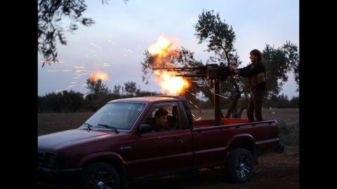 A Syrian opposition fighter fires at Bashar al-Assad Regime forces in the Handarat district of Aleppo on Thursday, November 20.