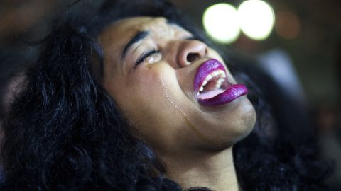 A demonstrator cries at a protest in Philadelphia on December 3.