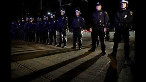 Police officers stand guard in New York's Times Square on December 3.