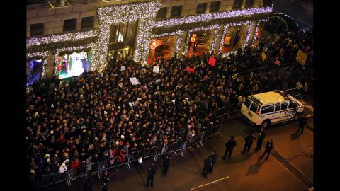 Protesters rally near Rockefeller Center during a ceremony to light the Rockefeller Center Christmas Tree in New York.