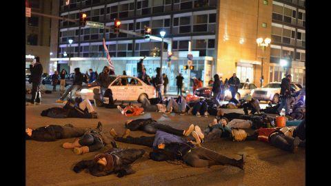 Demonstrators lie in the streets of St. Louis on December 3.