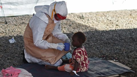 """The Ebola outbreak has seen over 1,400 new cases in Sierra Leone in the last three weeks alone, making the country set to eclipse Liberia as the worst-effected country on the globe, according to the <a href=""""http://apps.who.int/gho/data/view.ebola-sitrep.ebola-summary-latest?lang=en"""" target=""""_blank"""" target=""""_blank"""">World Health Organisation. </a>Here, a health worker in protective gear gives a drink to a tiny patient at the Kenama Treatment Center."""