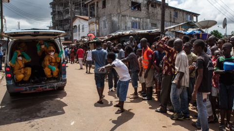 Volunteers arrive to pick up bodies of people who have died of the Ebola virus in Freetown, against a $100 weekly risk-taking compensation. The virus which has so far claimed over 1,400 lives across the country.