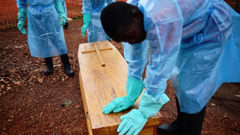"""""""I think one of the vital things we've failed to adhere to as a people, is not to touch a sick person,"""" said Johansen of a disease in which <a href=""""http://www.who.int/mediacentre/news/notes/2014/ebola-burial-protocol/en/"""" target=""""_blank"""" target=""""_blank"""">20% of transmissions happen during burials.</a> Here, government burial team members wearing protective clothing stand next to the coffin of Dr Modupeh Cole -- Sierra Leone's second senior physician to die of Ebola."""