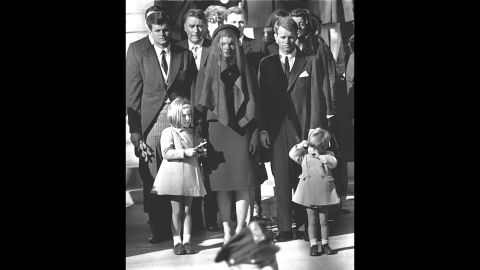 Jackie stands with her two children and her brothers-in law Ted Kennedy and Robert Kennedy at the funeral of her husband on November 26, 1963.
