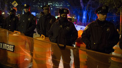 Police officers in New York staff a barricade at a Brooklyn Bridge exit ramp on December 4.