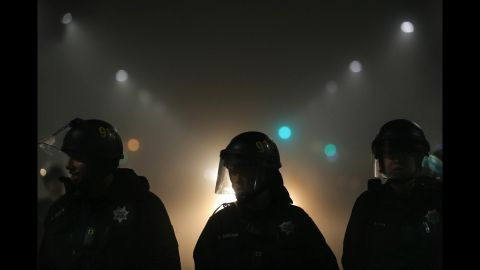 Police officers form a line with demonstrations under way in Oakland, California, on Thursday, December 4.