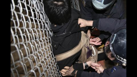 Police detain a protester in New York on December 4.