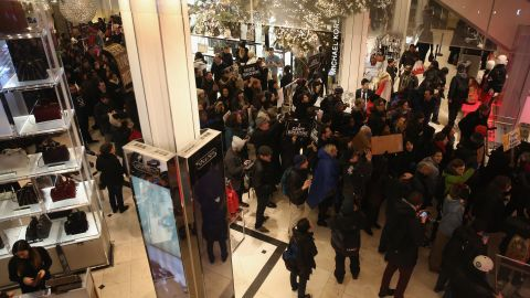 """Demonstrators march through a Macy's in Manhattan before staging a """"die-in"""" at the iconic department store on December 5."""