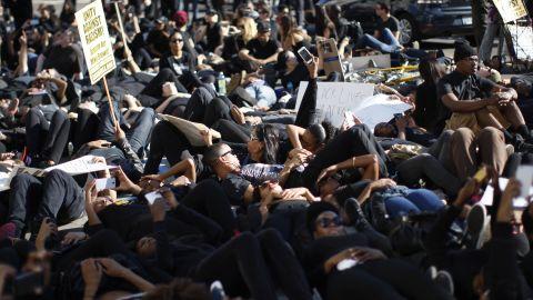 """People in Los Angeles lie down during a """"die-in"""" on Hollywood Boulevard on December 6."""