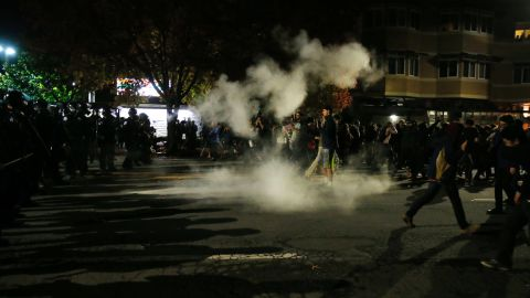 """Demonstrators retreat in Berkeley, California, after police deploy tear gas during a <a href=""""http://www.cnn.com/2014/12/07/justice/protests-grand-jury-chokehold/index.html"""">protest that turned violent</a> before dawn on December 7."""