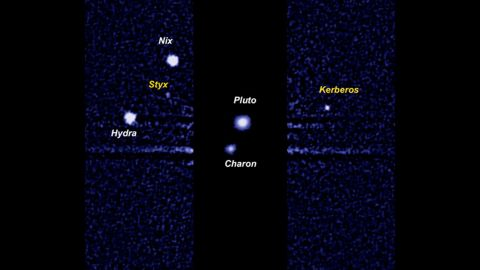 A Hubble Space Telescope image of Pluto and its moons. Charon is the largest moon close to Pluto. The other four bright dots are smaller moons discovered in 2005, 2011 and 2012: Nix, Hydra, Kerberos and Styx.