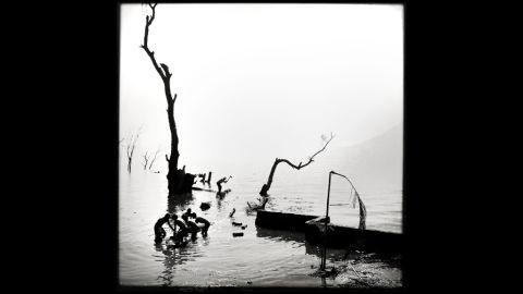 "<em>Logging</em> by <a href=""http://instagram.com/emencher"" target=""_blank"" target=""_blank"">Eric Mencher</a> (San Marcos La Laguna, Guatemala)"