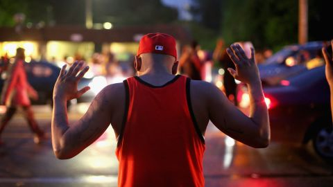 Demonstrators gather along West Florissant Avenue to protest the shooting of Michael Brown on August 15, 2014 in Ferguson, Missouri.