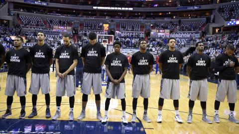 """Members of the Georgetown basketball team stand for the National Anthem wearing """"I Can't Breathe"""" t-shirts before an NCAA college basketball game against Kansas,  on Wednesday, December 10 in Washington."""