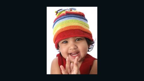 """<a href=""""http://shoppingforachange.org/"""" target=""""_blank"""" target=""""_blank"""">Shopping for a Change</a> works with artists around the globe, paying them up front for their products and work. This Rainbow Hat was made in Bangladesh with 50% the proceeds going to support a community project there and 50% to a nonprofit of your choosing."""