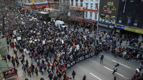 The protest moves down Sixth Avenue in New York on December 13.