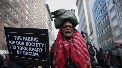 A woman marches down 14th Street in New York on December 13.