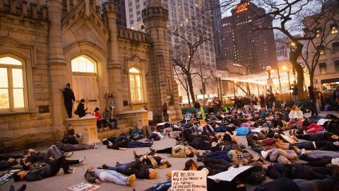 """Protesters stage a """"die-in"""" during a march in Chicago on December 13."""
