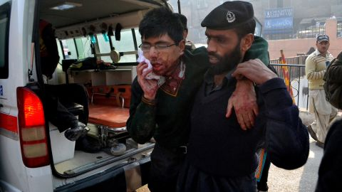 A hospital security guard helps an injured student at the school.