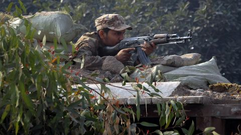 A Pakistani soldier takes position on a bunker close to the besieged school.