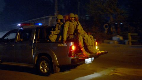 Pakistani soldiers patrol the streets near a school that was attacked by Taliban gunmen in Peshawar on December 16.